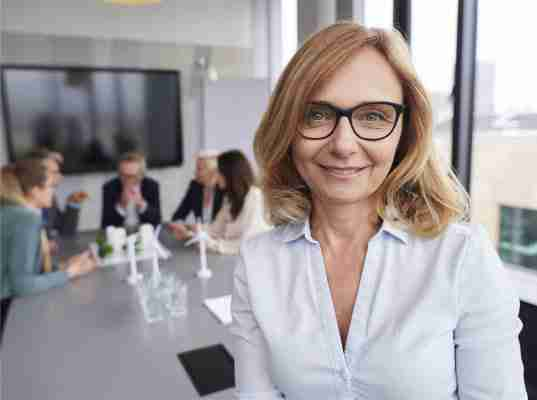 executive woman with office meeting background