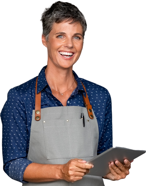 business woman wearing an apron and holding an ipad